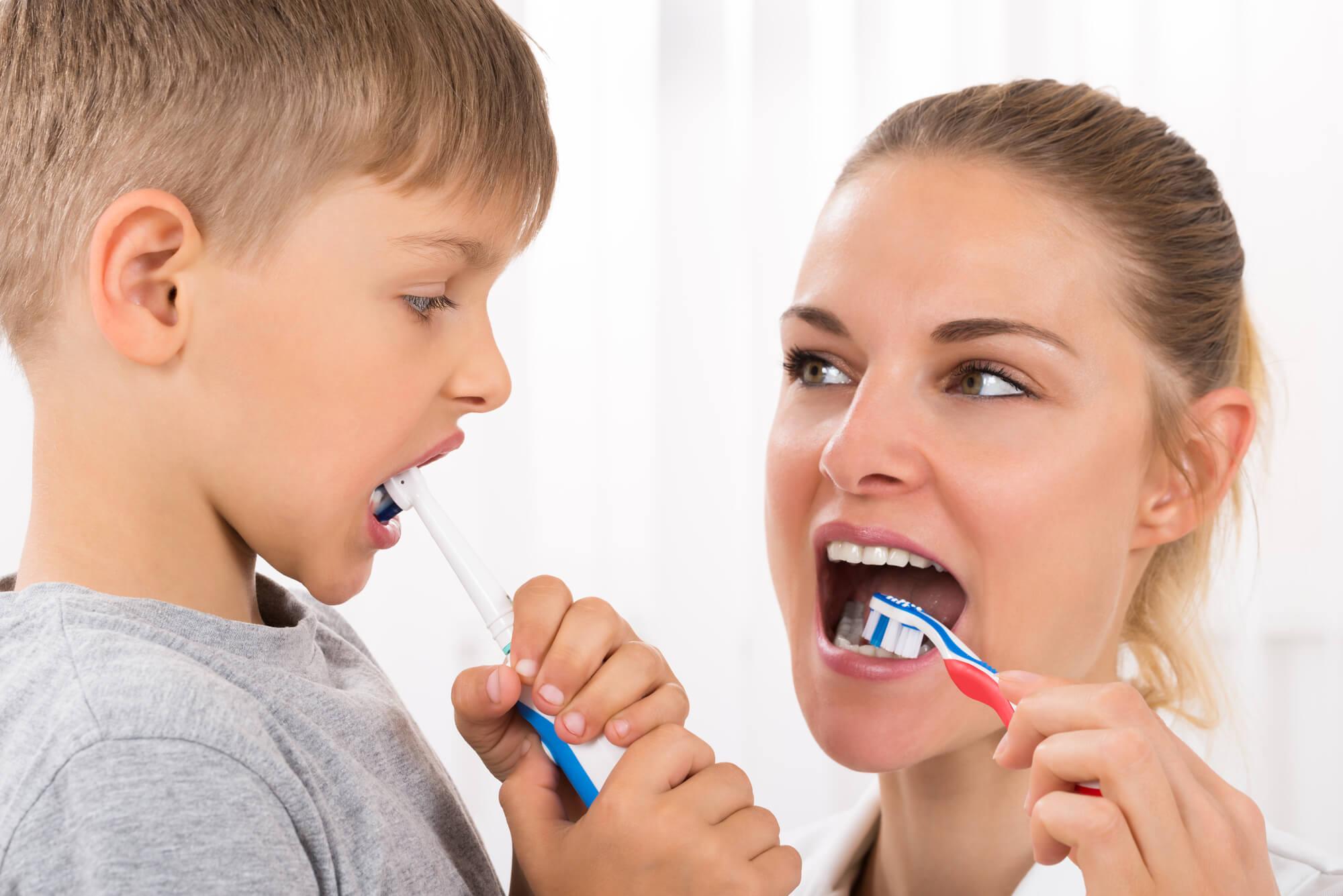brushing teeth before seeing Certified Pediatric Dentist 10952
